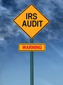 stock photo of irs  - warning irs audit conceptual road sign over sky - JPG
