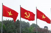 stock photo of hammer sickle  - Red Communist Flags in the wind in Vietnam - JPG