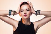 Glamour Portrait Of Beautiful Fashion Model Posing In Exclusive Jewelry. Professional Makeup And Hai