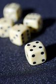 image of crap  - Close up of Craps on a anthracite background - JPG