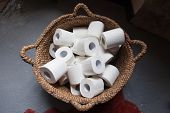 Toilet paper rolls in a basket.