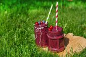 stock photo of fruit shake  - Fresh smoothie drink with different berries as healthy breakfast - JPG