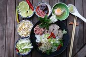 pic of rice noodles  - Vietnamese rice noodles are served with beef lime hoisin sauce and chili sauce and ready to eat - JPG