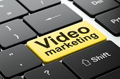 Business concept: Video Marketing on computer keyboard background