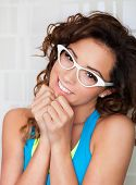 Young attractive shy woman wearing glasses