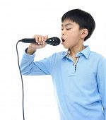 boy singing, with black microphone