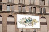 Advertising Billboard With Ddos Word Cloud Sign On Brick Wall