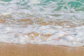Wave of the sea on the sandy beach