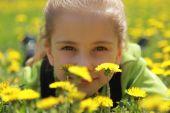 A girl is in dandelions