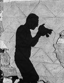 Schatten eines Fotografen an Wand