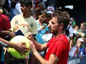 Tennis player Stanislas Wawrinka from Switzerland signing autographs after practice for US Open 2013