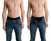 Shirtless man with jeans zipped and unzipped.