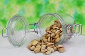 Pistachio nuts in vintage glass jar