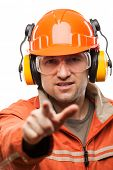 Construction building engineer or manual worker man in safety hardhat helmet finger pointing white isolated