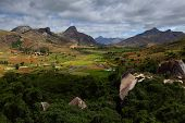 Green valley with rice fields and mountains with rocks. Madagascar