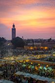 MARRAKESH, MOROCCO - NOVEMBER 7: Many people visit the Jemaa el Fna Square at sunset on November 7,