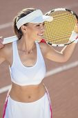 Woman With Tennis Racquet Smiling