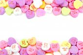 stock photo of purple white  - Double edge border of Valentines Day candy hearts over white - JPG
