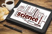 science branches word cloud on a digital tablet with a cup od coffee