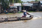 Vietnamese women rides the boat at Mekong Delta, South Vietnam