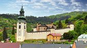 stock photo of banska  - castle of Banska Stiavnica with baroque church Slovakia - JPG