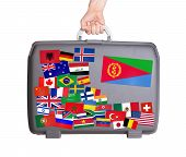 image of eritrea  - Used plastic suitcase with lots of small stickers large sticker of Eritrea - JPG