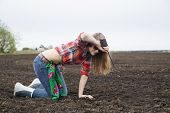 Woman Is Tired From Digging At Field