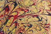 Traditional Turkish marbled paper artwork. Paper marbling is a method of water surface design, which