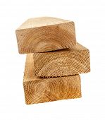 Edge of three cedar two by four wood boards on white background