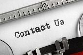 Contact Us written on an old typewriter concept for support, service and assistance