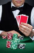 Croupier Holding Cards