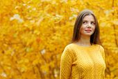 Autumn portrait of happy lovely and beautiful young woman