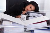 Businesswoman Sleeping On Piles Of Folders