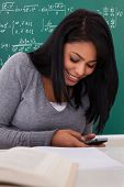 Portrait Of Female Student Using Cell Phone