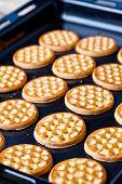 fresh homemade honey cookies on baking sheet
