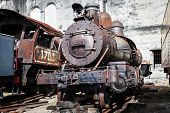 foto of locomotive  - old steam locomotive on the background wall - JPG