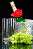 Champagne Flutes In Ice Bucket, Glasses And Grape