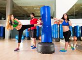 Boxing aerobox women group with personal trainer man at fitness gym