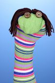 Cute sock puppet on blue background