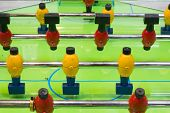 Table Football Game With Yellow And Red Players