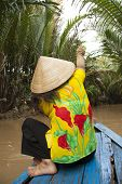 Vietnam woman in boat in jungle
