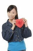 Beautiful Chinese Woman Holding A Red Heart