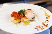 stock photo of buffet lunch  - White fish with cinnamon on a display in an open buffet restaurant  - JPG