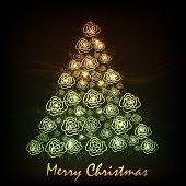 Merry Christmas celebration concept with beautiful X-mas tree made by flowers on shiny brown background.