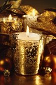 Candles lit with a sparkling gold theme for the holidays