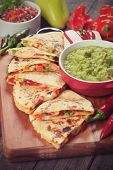 Mexican quesadillas with cheese, vegetable and guacamole dip