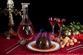 Christmas dinner table with xmas pudding as dessert