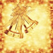 Golden jingle bells, Christmas tree ornament and holiday decoration on blurry background, beautiful greeting card for wintertime holidays
