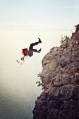 businessman fall from cliff background