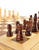 chess figures on board isolated at white background